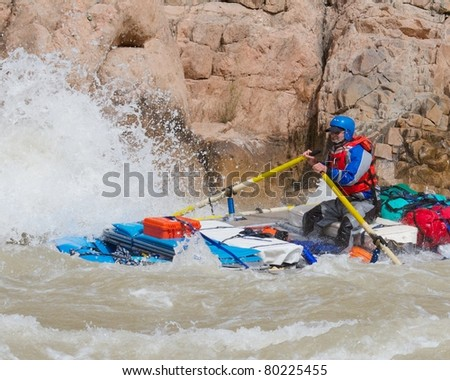 Rafter Punching the Wave - Grand Canyon National Park