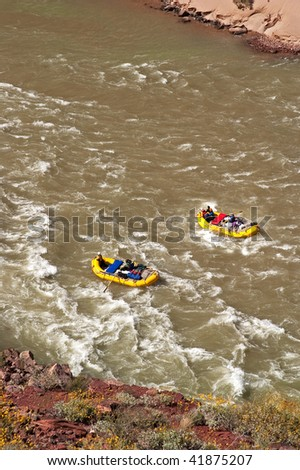 Rafters going through Hance Rapids, on Colorado River, in Grand Canyon.