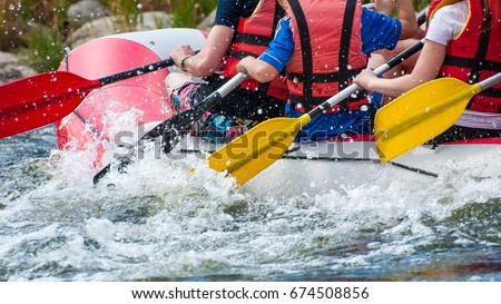 Rafting. Close-up view of oars with splashing water