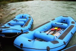 rafting race in blue boats
