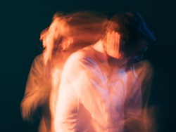 Rage man. Bipolar disorder. Psychology stress. Toxic relationship. Conceptual art portrait. Surreal aggressive screaming guy reflecting each other isolated green blur light double exposure.