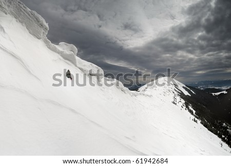 rage photographer under the snow cornices