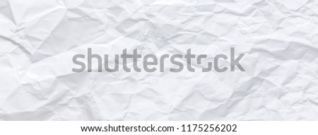 Ragged crumpled white paper texture with wrinkles, banner background