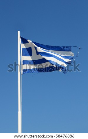 Ragged flag of Greece waving in wind vertical