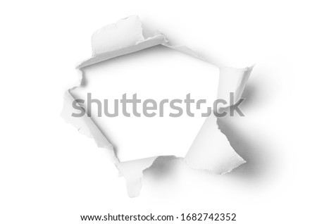 Ragged hole torn in ripped paper, isolated on white background Foto stock ©