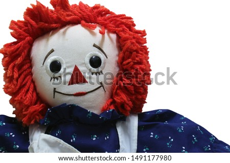 Raggedy Ann doll on white background, Old Time Rag Doll, Ghost mystic doll. Scary horror doll