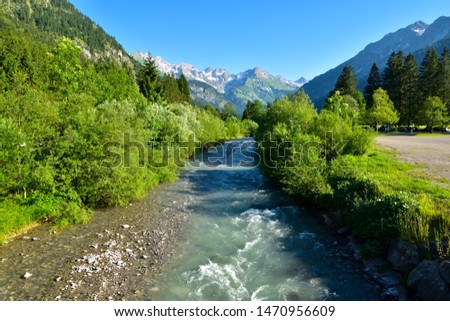 Raging mountain river in mountain landscape.