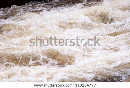 Raging River Flood Water with white foam - stock photo