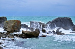 raging sea, storm near the shore. beautiful seascape, cloudy weather in the rainy season. there is room for text. water element.  beautiful blue water color