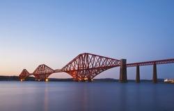 Rail Bridge over The Firth of Forth, crossing between Fife and Edinburgh at dusk, Scotland. Night scene