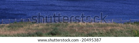 Rail Fence Along The Shore