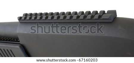 rail on top of a shotgun receiver to mount lights or sights
