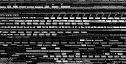 Rail way art Artistic black and white horizontal composition. Aerial Top view to railway cylindrical tank shipping containers. Striped creative transport industry representation.  railroads and trains