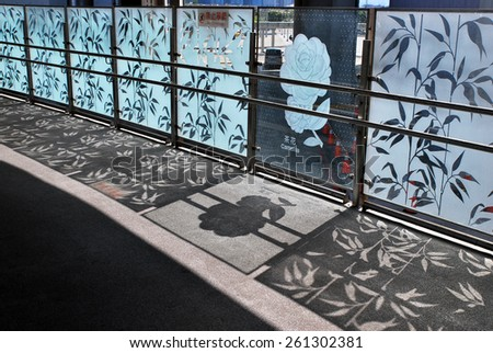 Railing and decorated glass as fence and reflections in the Station