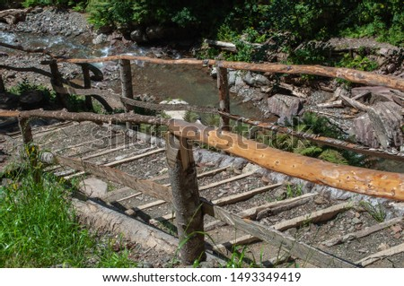 railings and steps of walking trails of the national park in the forest of the Caucasus mountains #1493349419