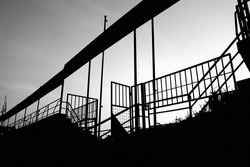 Railings of former dilapidated soccer staium in Brno, Czech Republic, in black and white with high contrast.