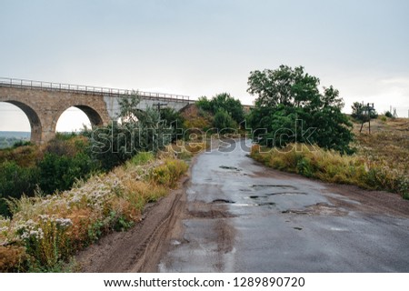 Railroad bridge in mountains. Mountain railroad bridge scene. Railroad bridge and landscape