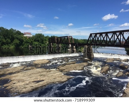 Railroad bridge over Kennebec River in Waterville, Maine #718999309