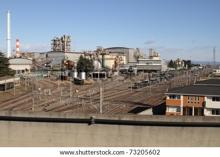 Railroad cars line up to be loaded at Cement manufacturing plant - stock photo