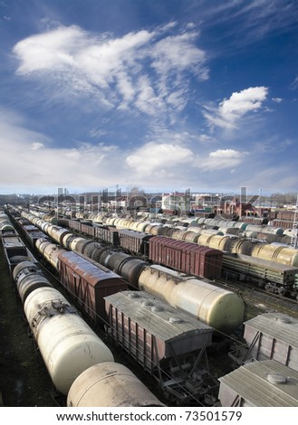 Railroad cars on a railway station. Cargo transportation. Work of industry. Urban scene