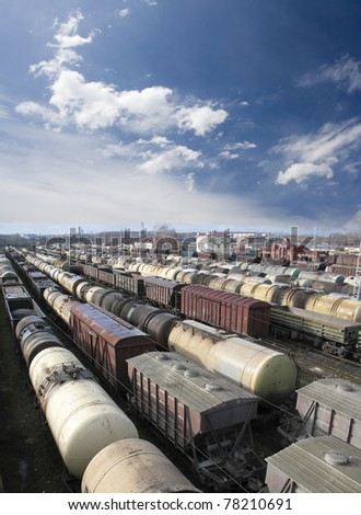 Railroad cars on a railway station. Cargo transportation. Work of industry. Urban scene. Train - stock photo