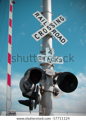 railroad crossing gate with blue sky