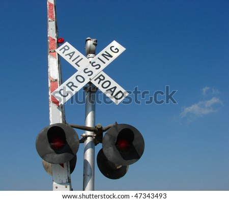 railroad crossing sign and gate
