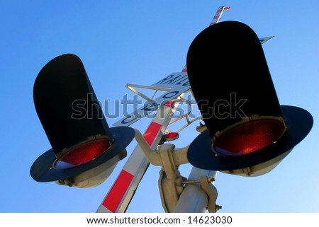 Railroad Crossing signal from below with sky in the background