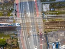 Railroad crossing street aerial in Groningen city, Netherlands