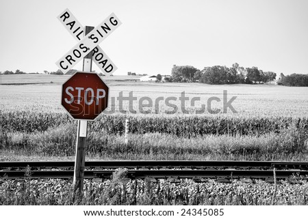 Railroad crossing with stop warning sign