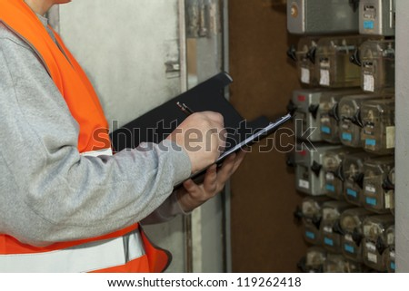 Railroad employee near the electrical (relay) enclosure