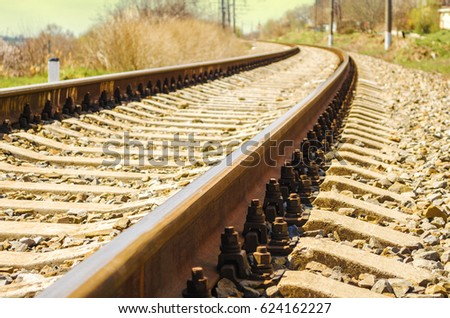 Railroad in motion at sunset. Railway station with motion blur effect, Industrial concept background. Railroad travel, railway tourism. Blurred railway. Transportation. Shallow depth of field