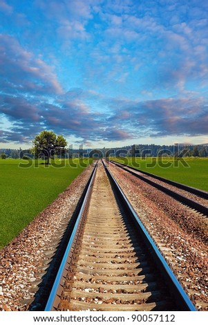 Railroad in the field on beautiful day