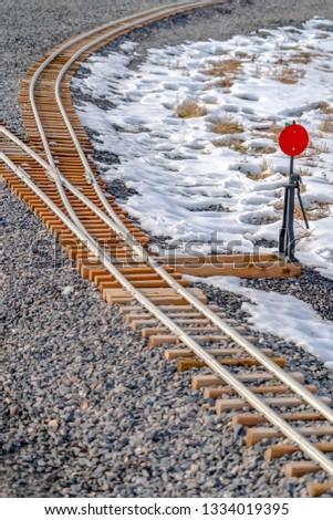 Railroad switch on a railroad junction in winter #1334019395