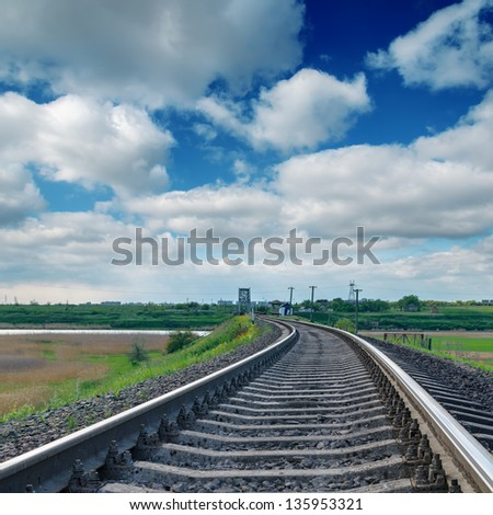 railroad to horizon under clouds