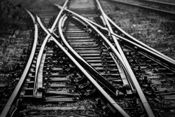 Railroad Track Switches at railway junction - monochrome image