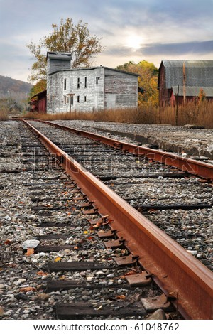 Railroad Tracks And Dilapidated Buildings During Autumn, New York State