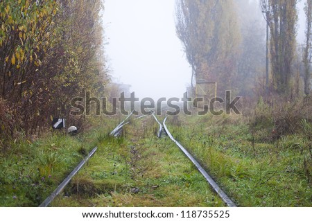 railroad tracks and switch in the fog