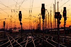 Railroad Tracks at a Major Train Station at Sunset.