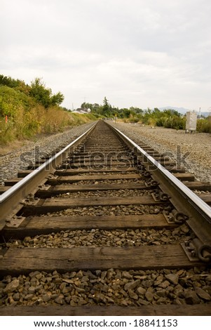 Railroad tracks disappearing into a point in the distance