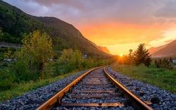 Railroad tracks in the setting sun