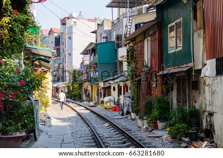 Railroad tracks on a street in the center of Hanoi, Vietnam
