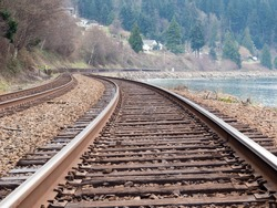 Railroad tracks running along the ocean shore in the Pacific Northwest