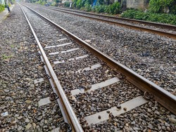 Railroad tracks shoot after rain. Leading line view