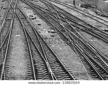 Railroad tracks. Top view. Black and white image, monochrome.