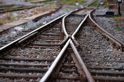 Railroad tracks with a junction on the front