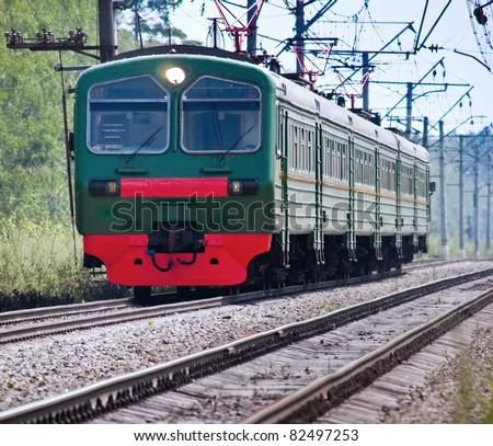 railroad train in motion the arrival of - stock photo