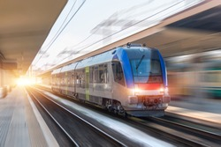 Railroad travel passenger train with motion blur effect, industrial concept, tourism