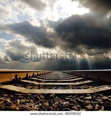 railroad under dramatic sky