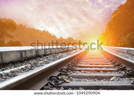 Railroad with beautiful sky sunset. Industrial landscape with railway station, colorful twilight sky, yellow sunlight. move forward to gold, reach to the sky concept. #1049290904